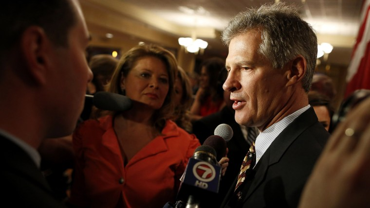 Republican Scott Brown talks to the media after announcing his bid for the United States Senate primary election in Portsmouth, New Hampshire, April 10, 2014.