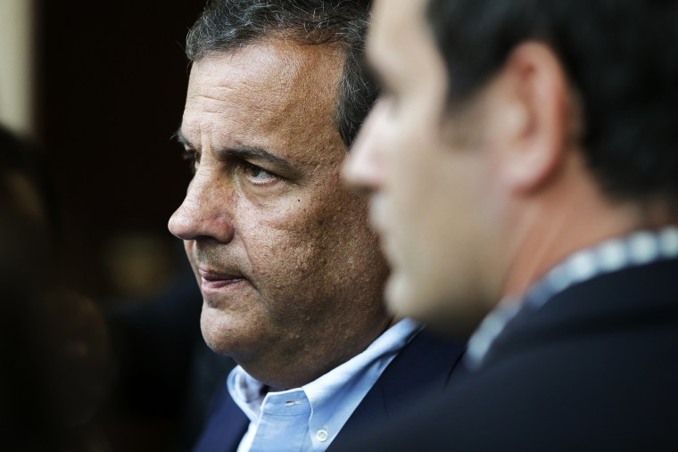 Chris Christie talks with reporters at the National Governors Association convention, July 12, 2014.