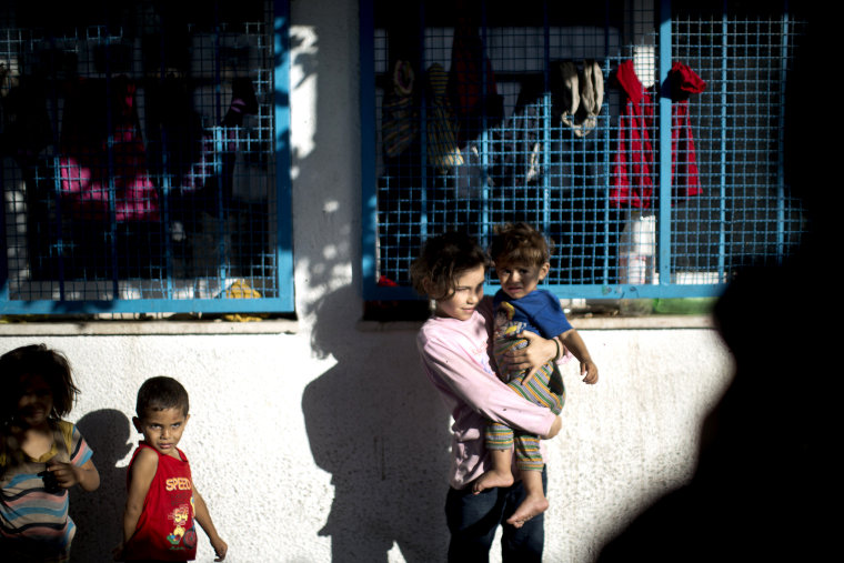 Palestinian children take refuge at a UN school after evacuating their homes near the border at the Jabaliya refugee camp in the Gaza Strip on July 15, 2014.