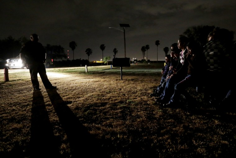 A group of immigrants from Honduras and El Salvador, who crossed the U.S.-Mexico border illegally, are stopped in Granjeno, Texas, on June 25, 2014.