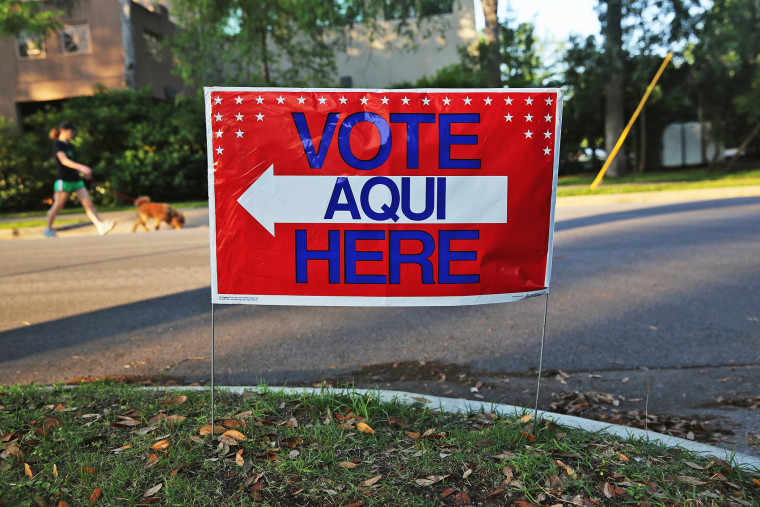A bilingual sign stands outside a polling center at public library ahead of local elections on April 28, 2013 in Austin, Texas.