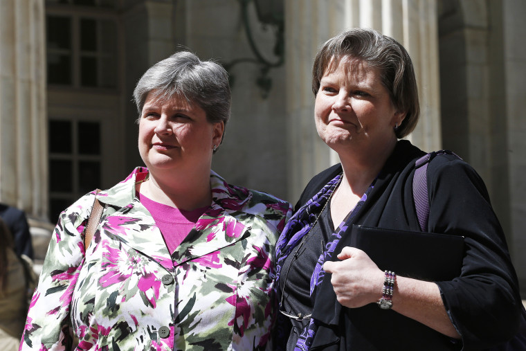 In this April 17, 2014 file photo, plaintiffs challenging Oklahoma's gay marriage ban, Sharon Baldwin, left, and her partner Mary Bishop, leave court following a hearing at the 10th U.S. Circuit Court of Appeals in Denver.