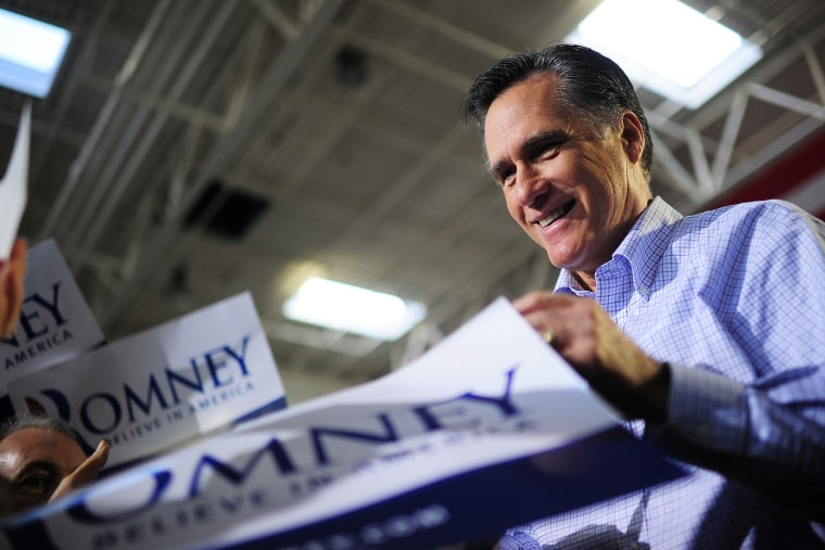 Former Republican presidential nominee Mitt Romney greets supporters as he holds a campaign rally  in Jacksonville, Fla., on Jan. 30, 2012.