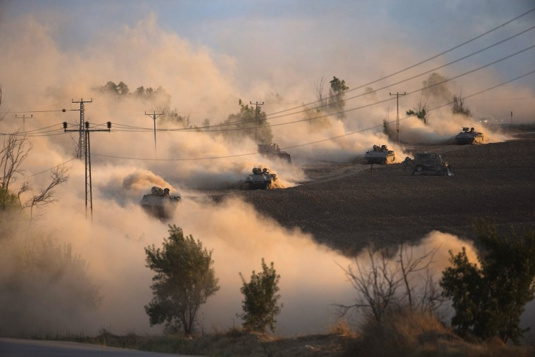 Israeli tanks manoeuvre outside the northern Gaza Strip
