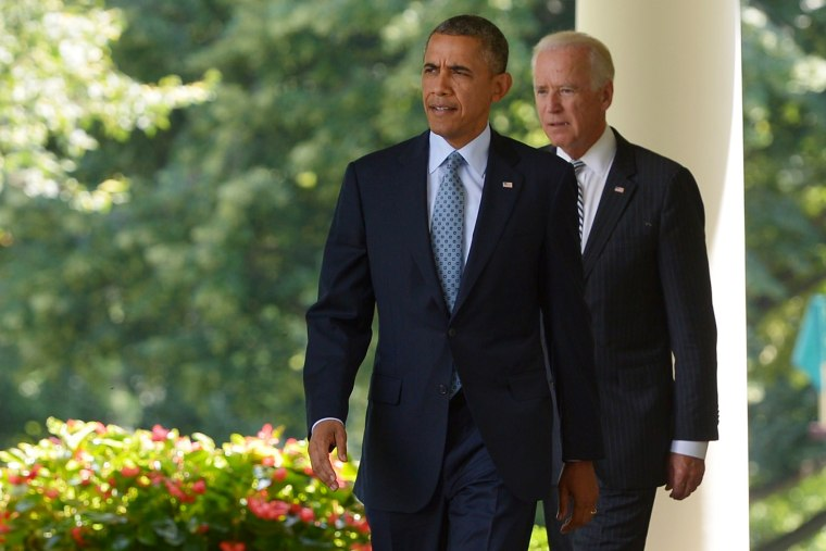 US President Barack Obama and Vice President Joe Biden make their way to the Rose Garden to speaks on immigration reform on June 30, 2014 at the White House in Washington, DC.