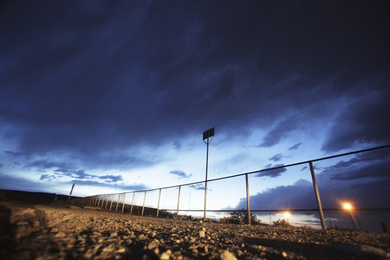 The fence marking the border between Mexico and the U.S. is seen in the Anapra neighborhood of Ciudad Juarez, May 23, 2014.