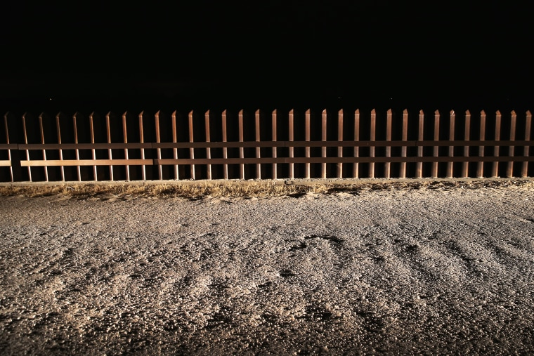 A section of the U.S.- Mexico border fence stands on April 10, 2013 in La Joya, Texas.