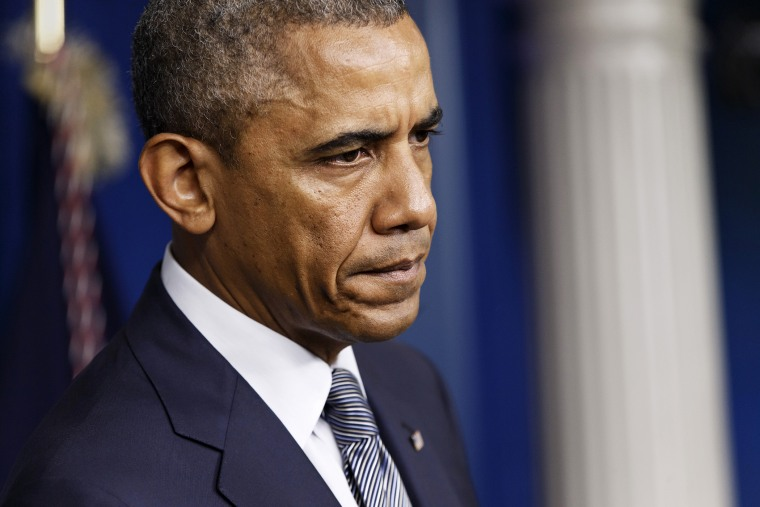 President Barack Obama pauses while speaking about the situation in Ukraine, July 18, 2014, in the Brady Press Briefing Room of the White House in Washington, D.C.