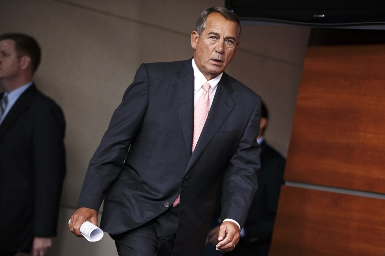 John Boehner arrives for a news conference on Capitol Hill in Washington, July 17, 2014.