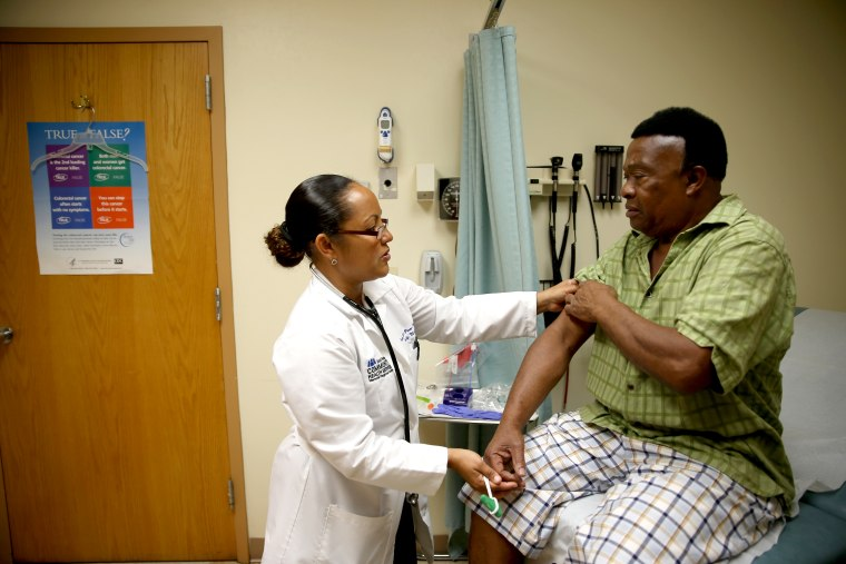 Felue Chang, who is newly insured through the Affordable Care Act, receives a checkup, April 15, 2014 in Hollywood, Florida.