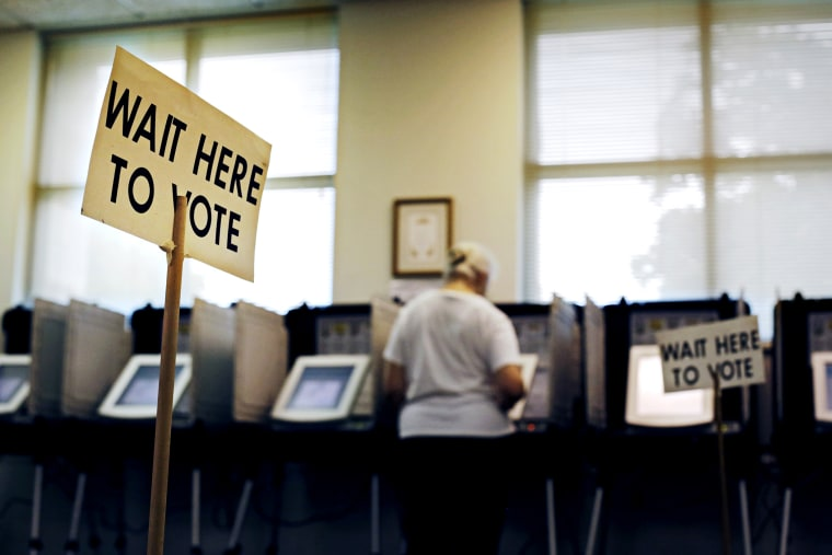 A sign greets voters before they step up to cast their ballot at a polling site, Tuesday, July 22, 2014, in Atlanta.
