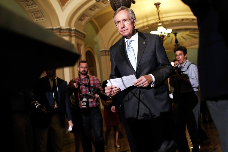 Senate Majority Leader Harry Reid (D-NV) arrives at a press conference following the weekly Democratic policy luncheon July 15, 2014 at the U.S. Capitol in Washington, DC.