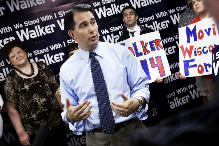Wisconsin Gov. Scott Walker addresses members of the media during a stop at the Madison GOP field office in Madison, Wis., Wednesday, July 23, 2014.