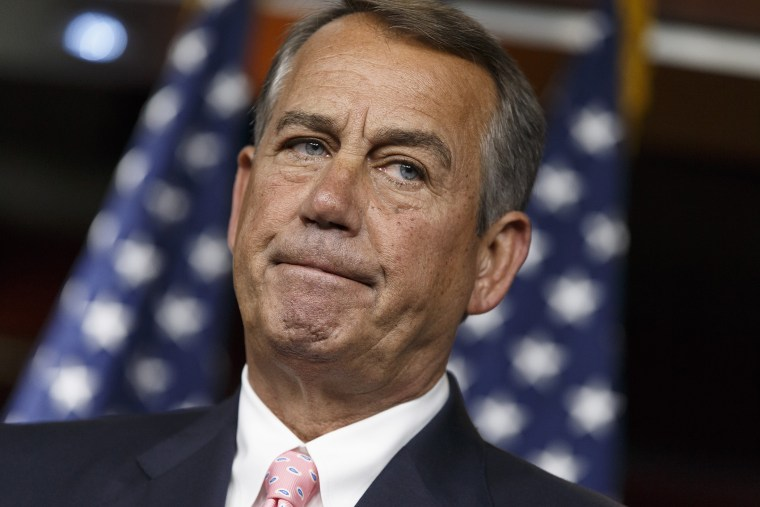 Speaker of the House John Boehner, R-Ohio, talks with reporters on Capitol Hill in Washington, Thursday, July 24, 2014.