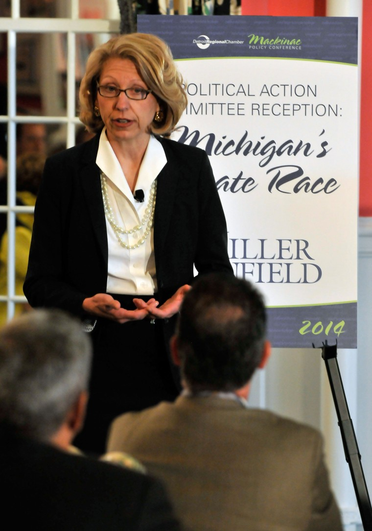 Former Michigan Secretary of State Terri Lynn Land talks during a Political Action Committee reception Wednesday, May 28, 2014, at the 2014 Mackinac Policy Conference at the Grand Hotel on Mackinac Island, Mich.