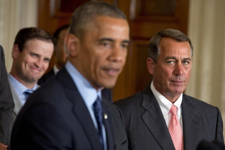 House Speaker John Boehner, R-Ohio, watches President Barack Obama speak during a ceremony in the East Room of the White House, Tuesday, June 24, 2014.