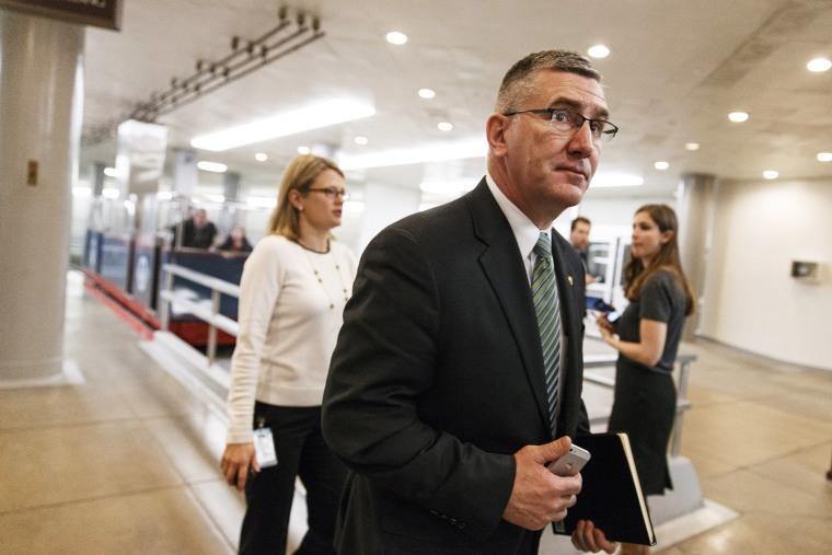 Sen. John Walsh walks to the Senate chamber on Capitol Hill in Washington, Feb. 12, 2014.