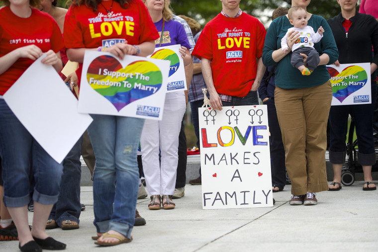 Gay rights supporters hold rally on Pennsylvania State Capital steps after ruling struck down ban on same-sex marriage in Harrisburg