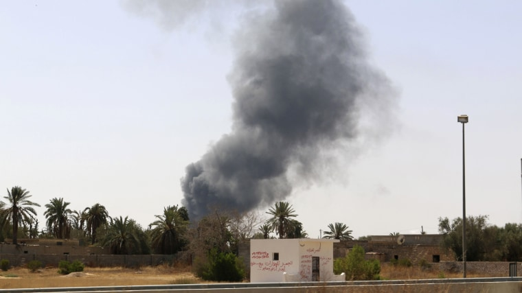 Smoke rises over the Airport Road area after heavy fighting between rival militias broke out near the airport in Tripoli July 25, 2014.