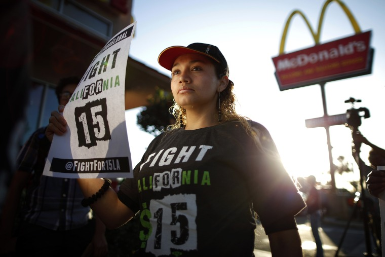 Demonstrators take part in a protest to demand higher wages for fast-food workers outside McDonald's in Los Angeles, Calif., May 15, 2014.