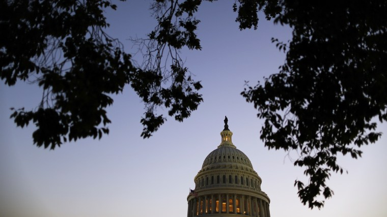 Night falls over the U.S. Capitol.