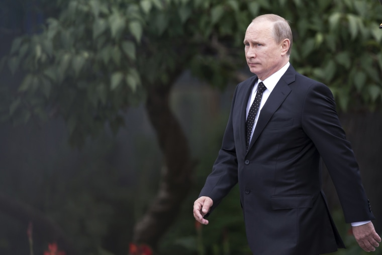 Russian President Vladimir Putin arrives at an event in Moscow, Russia, June 22, 2014.