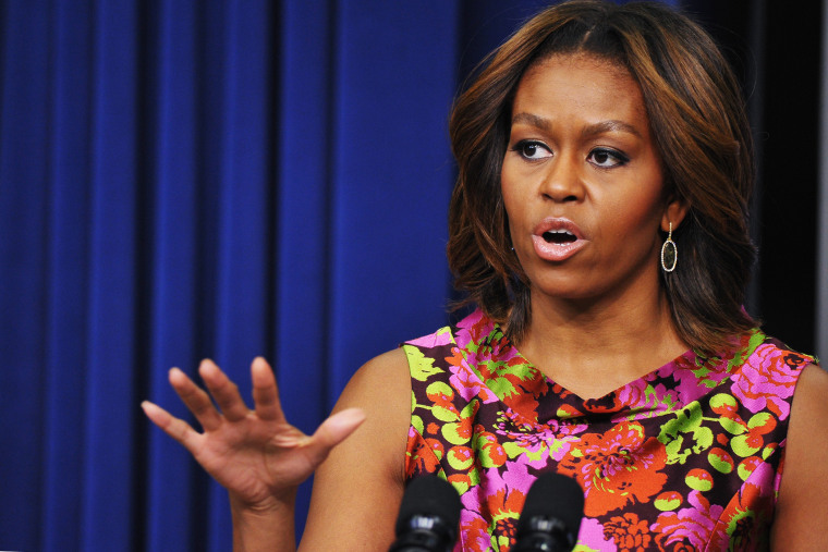 US First Lady Michelle Obama speaks in the Eisenhower Executive Office Building next to the White House in Washington, D.C., Feb. 24, 2014.