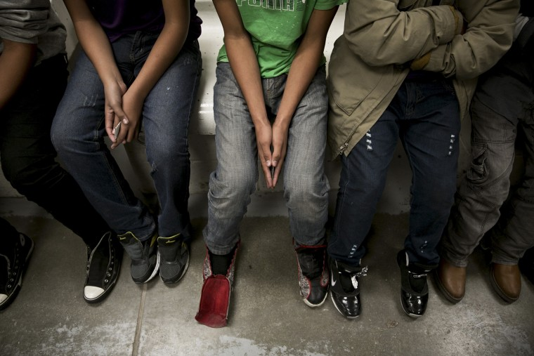Undocumented immigrant minors from Central America are processed at the U.S. Border Patrol Fort Brown Station in Brownsville, Texas, March 25, 2014.