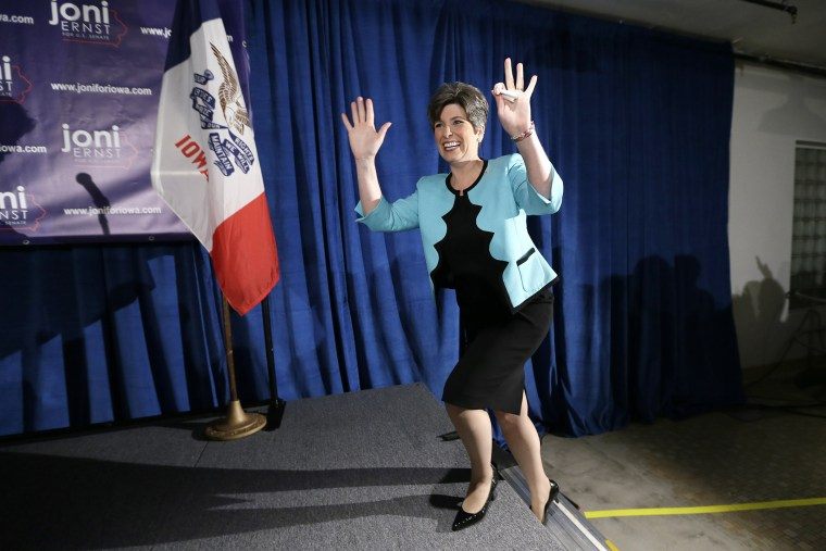 State Sen. Joni Ernst waves to supporters at a primary election night rally in Des Moines, Iowa, June 3, 2014.