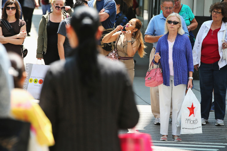 Shoppers visit stores along a section of Michigan Avenue on July 29, 2014 in Chicago, Illinois.