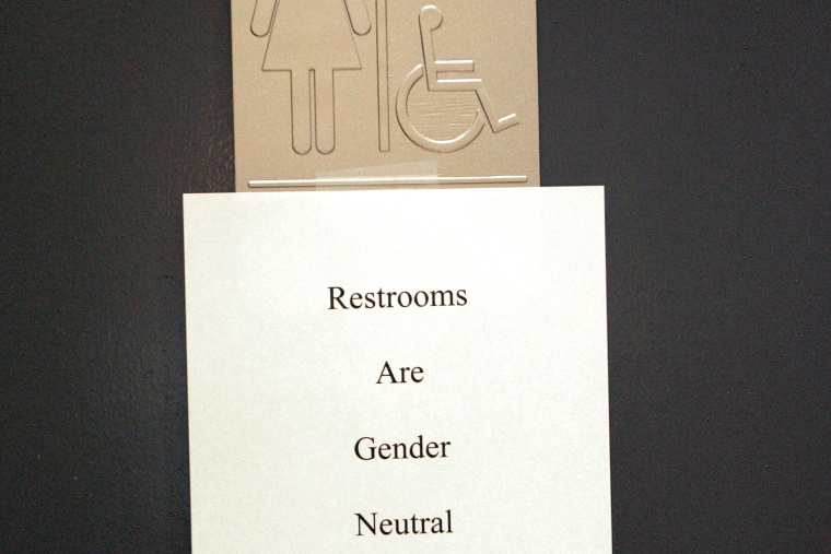A sign is posted at the entrance of a restroom in n West Hollywood, CA.