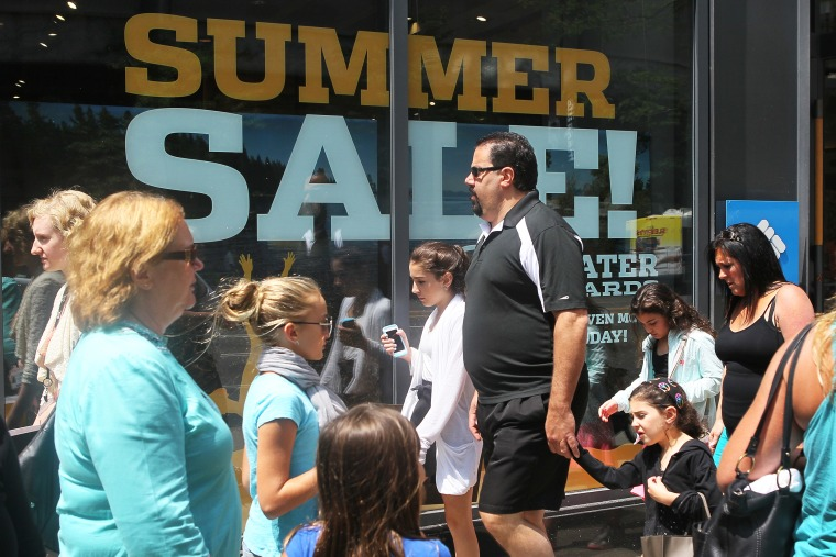 Shoppers visit stores along a section of Michigan Avenue, July 29, 2014 in Chicago, Illinois.