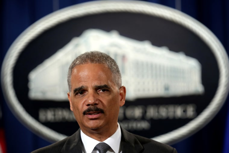 Attorney General Eric Holder at the Justice Department July 14, 2014.