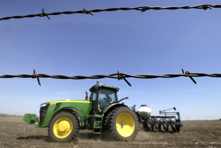A farmer plants corn in a field near De Soto, Iowa on May 5, 2014.
