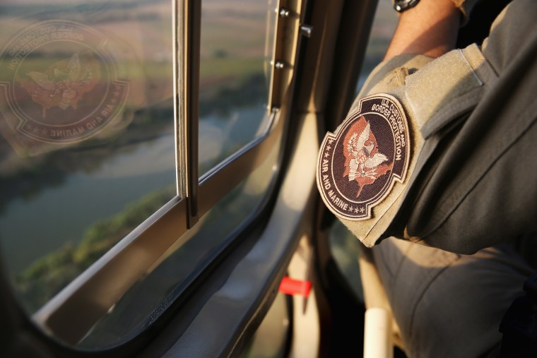 Pilots from the U.S. Office of Air and Marine patrol over the Rio Grande River on July 25, 2014 near Mission, Texas.
