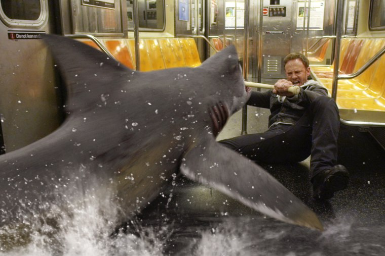 """In this image released by Syfy, Ian Ziering, as Fin Shepard battles a shark on a New York City subway in a scene from \""""Sharknado 2: The Second One."""