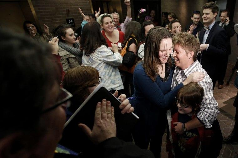 Kim Hackford-Peer marries her partner Ruth Hackford-Peer as Ruth holds their son Casey, 7, at the Salt Lake County office building in Salt Lake City, Utah