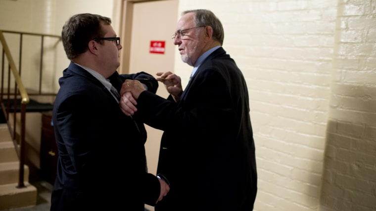 Rep. Don Young, R-Alaska, confronts an aide who tried to stop him from entering the side door of a House Republican meeting in the Capitol, July 31, 2014.