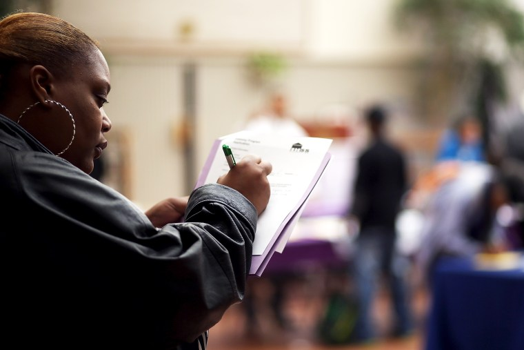 A job seeker fills out an application during a career fair on May 21, 2014 in San Francisco, California.