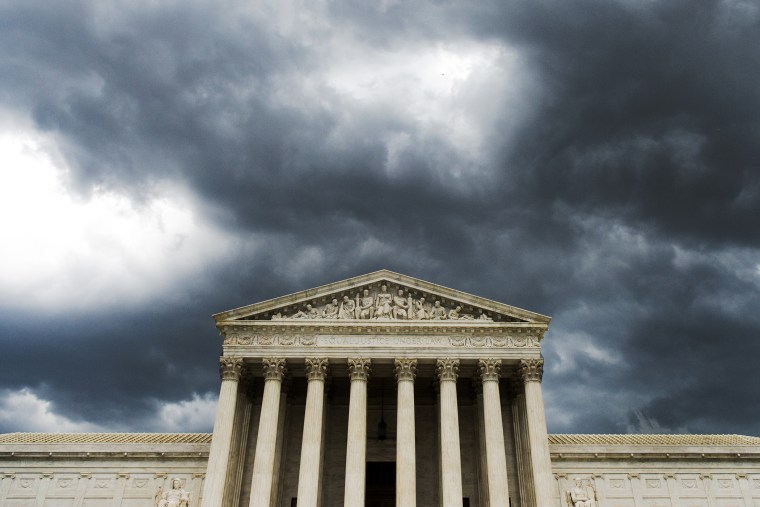 A strong storm front passes over the U.S. Supreme Court on Tuesday, July 8, 2014.