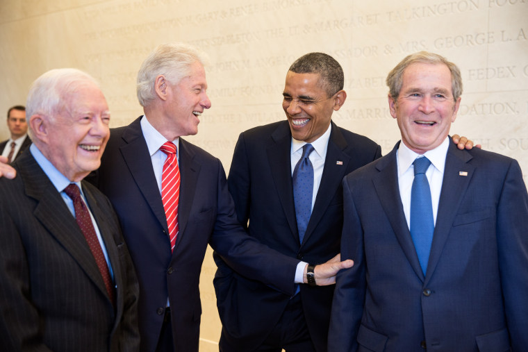 President Barack Obama laughs with former Presidents Jimmy Carter, Bill Clinton, and George W. Bush on the campus of Southern Methodist University in Dallas, Texas, April 25, 2013.