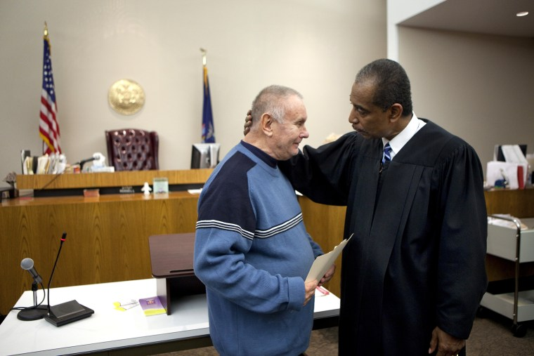 Veteran Richard Wilkiewicz (L) is congratulated by Judge Robert Russell at the Buffalo Veterans Treatment Court as he successfully completed his program, on Oct. 23, 2012 in Buffalo, New York.
