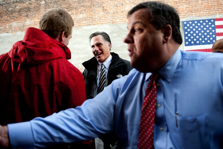 Mitt Romney and Chris Christie talk with supporters in Delaware, Ohio, October 10, 2012.