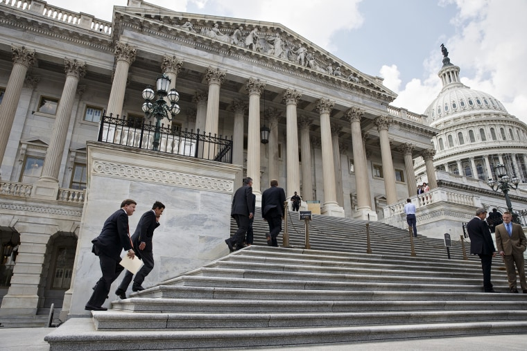 Members Congress clinm the steps of the House of Representatives for final votes, at the Capitol in Washington, on July 31, 2014.