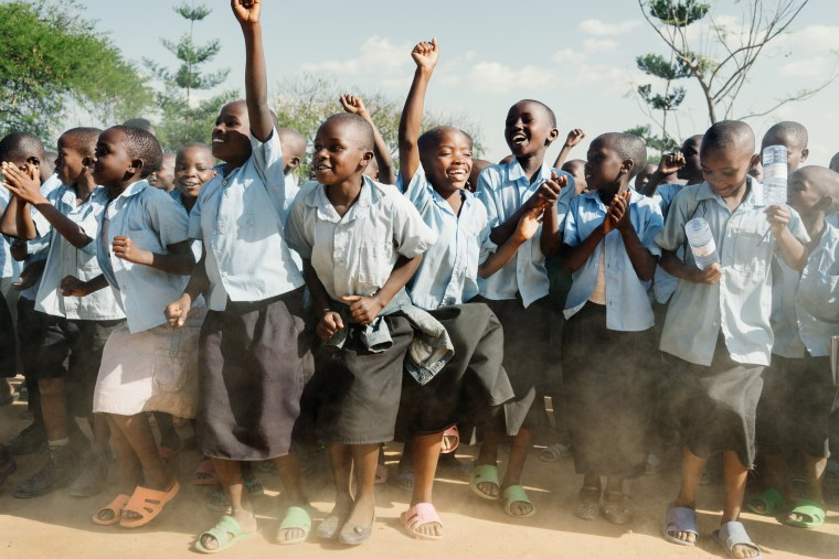 Young children prepare to celebrate a library dedication ceremony and to welcome Ambassador Dho Young-shim, a Member of the UN Millennium Development Goals Advocacy Group at a primary school in Mayange, Rwanda on July 3rd, 2014.