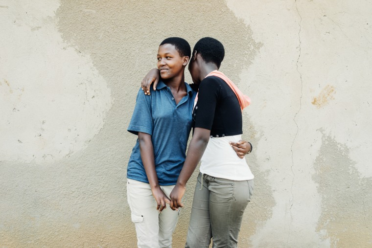Best friends Chantal Iradukunda and Alice Ingabire pose for a photo after church.Aeer Anglican Association Church, Mayange, Rwanda, July 6th, 2014Note:...