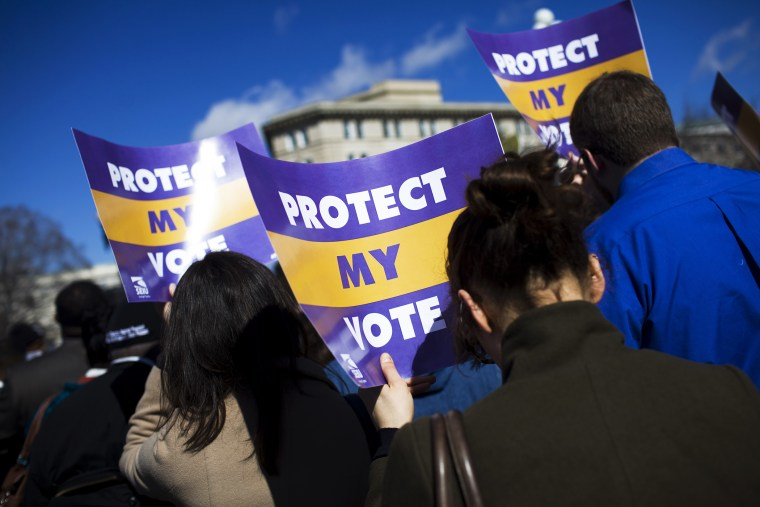 Protestors gather outside of the U.S. Supreme Court in support of Section 5 of the Voting Rights Act of 1965, in Washington, Feb. 27, 2013.