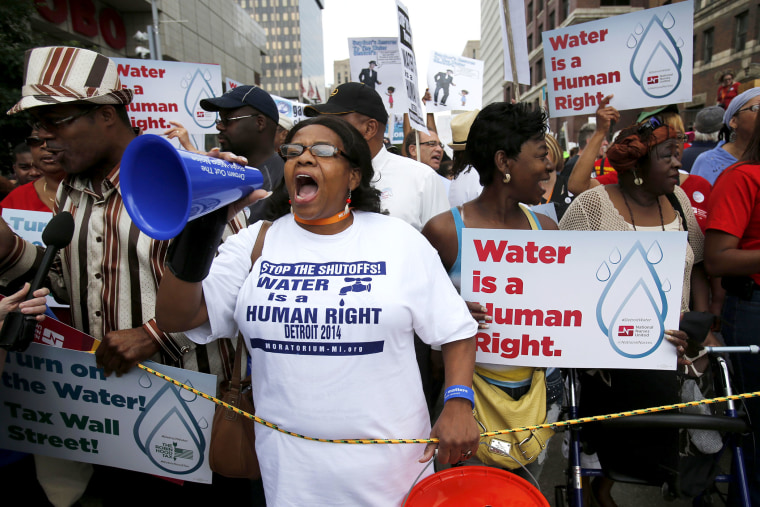 People gather to protest against the mass water shut-offs to Detroit citizens behind in their payments, July 18, 2014.