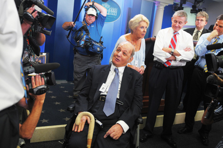 James Brady (C), former White House press secretary for president Ronald Reagan, and his wife Sarah (3rd L) chat with journalists, June 16, 2009.