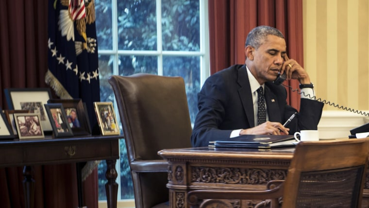 US President Barack Obama speaks on the phone with King Abdullah II of Jordan in the Oval Office of the White House on August 8, 2014 in Washington, DC.